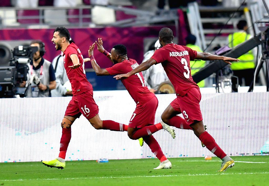 DOHA, Dec. 3, 2019 - Boualem Khoukhi (1st L) of Qatar celebrates after scoring during the 24th Arabian Gulf Cup 2019 Group A football match between Qatar and United Arab Emirates (UAE) at the Khalifa ...