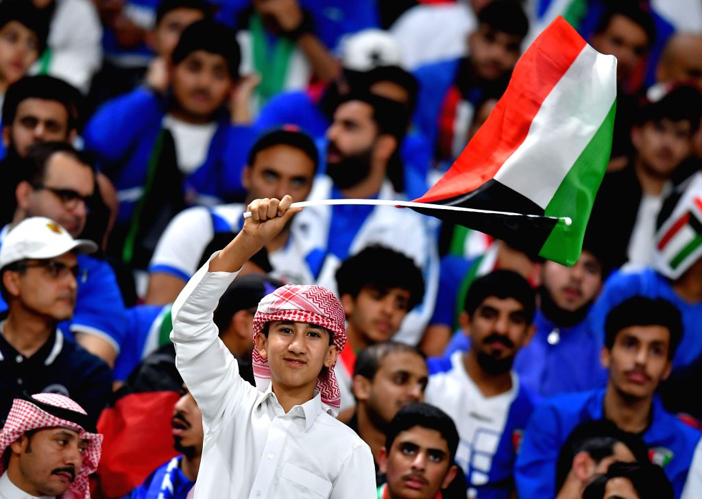 DOHA, Dec. 3, 2019 - Fans of Kuwait cheer for the team during the 24th Arabian Gulf Cup 2019 Group B football match between Kuwait and Bahrain in Doha, Qatar, Dec. 2, 2019.
