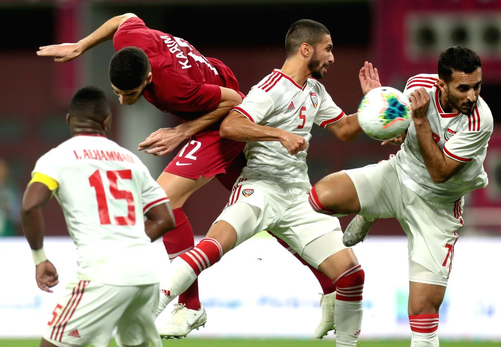 DOHA, Dec. 3, 2019 - Karim Boudiaf (2nd L)of Qatar competes during the 24th Arabian Gulf Cup 2019 Group A football match between Qatar and United Arab Emirates (UAE) at the Khalifa International ...