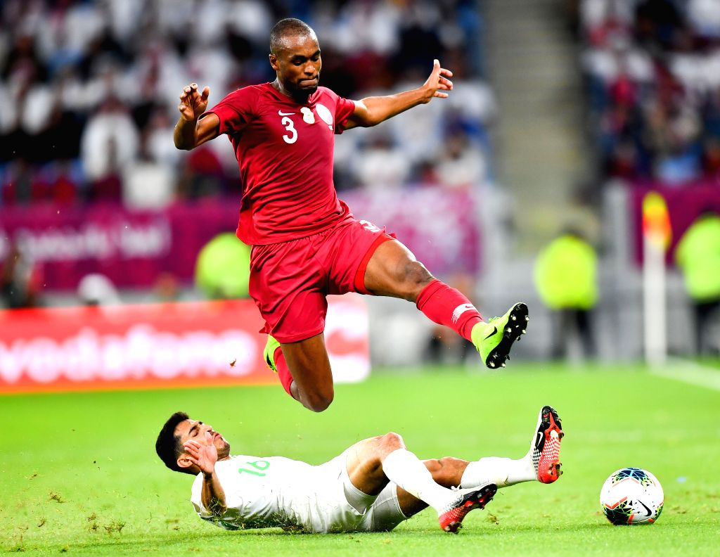 DOHA, Dec. 6, 2019 - Abdelkarim Hassan (top) of Qatar vies with Sultan Al Ghanam of Saudi Arabia during the 24th Arabian Gulf Cup 2019 semifinal match between Qatar and Saudi Arabia in Doha, Qatar, ... - Abdelkarim Hassan