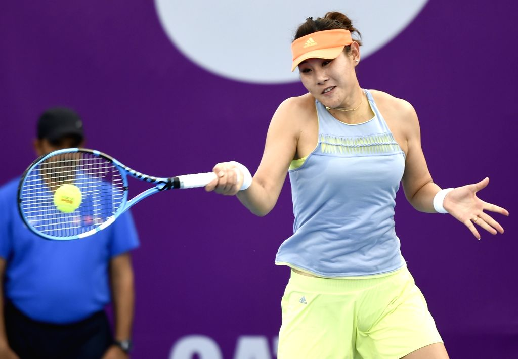 DOHA, Feb. 12, 2018 - Duan Yingying of China hits a return during the qualifying match against Vera Zvonareva of Russia at the 2018 WTA Qatar Open in Doha, Qatar, on Feb. 11, 2018. Duan Yingying won ...