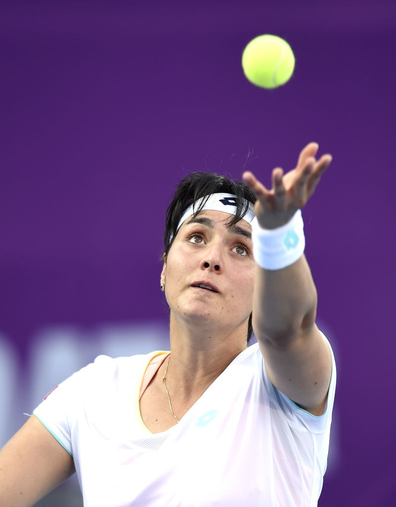 DOHA, Feb. 12, 2018 - Ons Jabeur of Tunisia serves during the single's first round match against Duan Yingying of China at the 2018 WTA Qatar Open in Doha, Qatar, on Feb. 12, 2018. Duan Yingying won ...