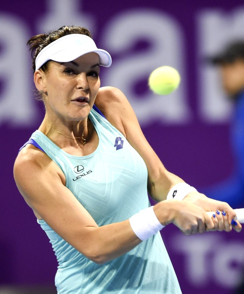 DOHA, Feb. 13, 2018 - Agnieszka Radwanska of Poland hits a return during the single's first round match against Mona Barthel of Germany at the 2018 WTA Qatar Open in Doha, Qatar, on Feb. 12, 2018. ...