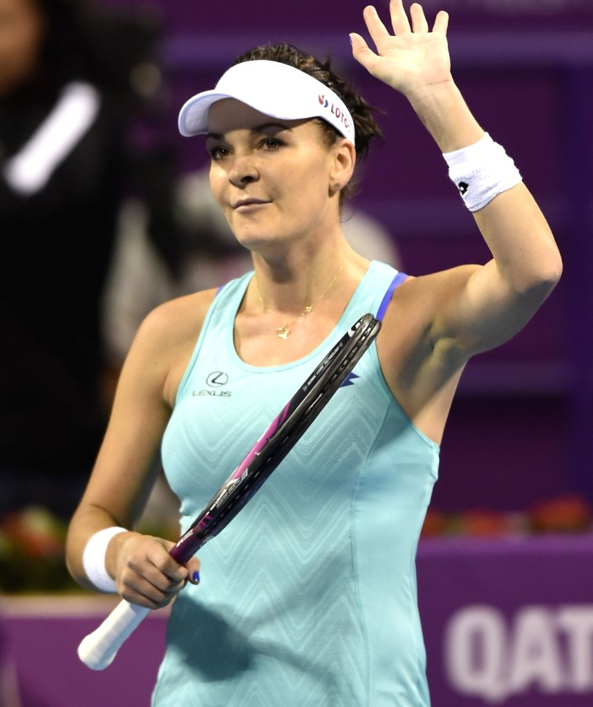 DOHA, Feb. 13, 2018 - Agnieszka Radwanska of Poland greets the audiences after the single's first round match against Mona Barthel of Germany at the 2018 WTA Qatar Open in Doha, Qatar, on Feb. 12, ...