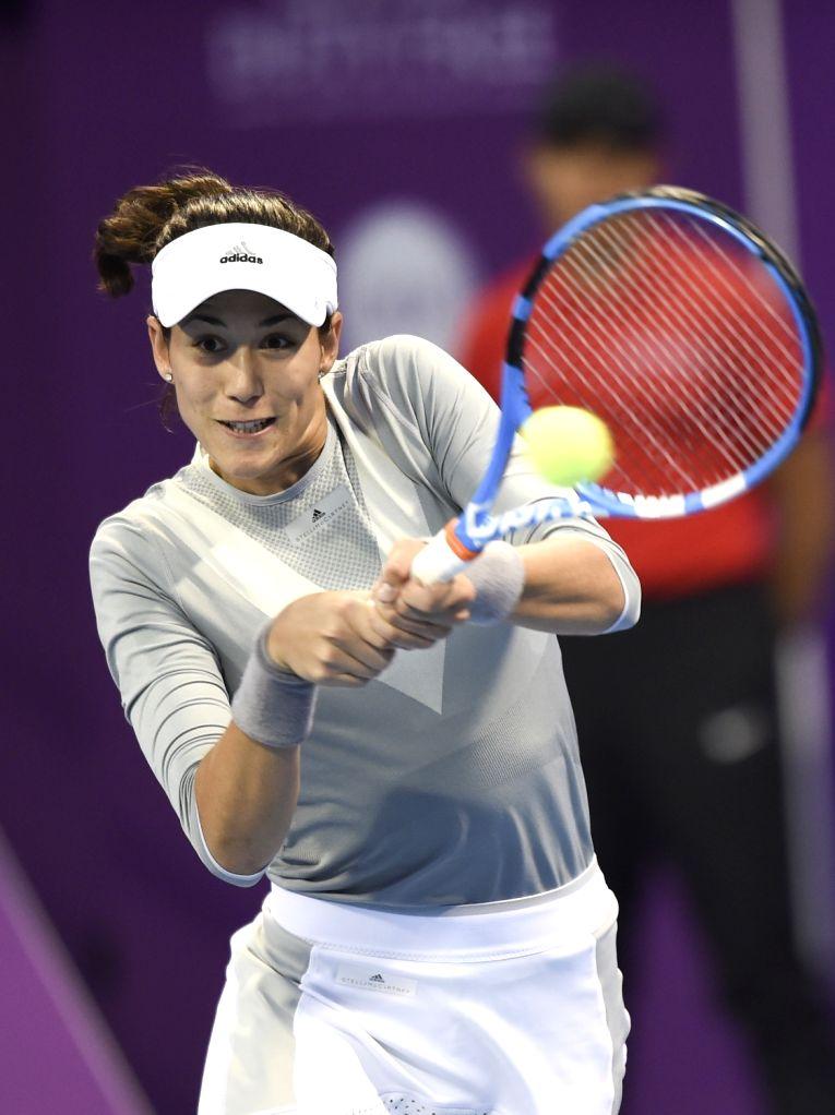 DOHA, Feb. 13, 2018 - Garbine Muguruza of Spain hits a return during the single's second round match against Duan Yingying of China at the 2018 WTA Qatar Open in Doha, Qatar, on Feb. 13, 2018. ...