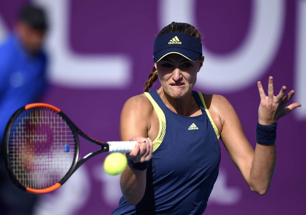 DOHA, Feb. 13, 2018 - Kristina Mladenovic of France hits a return during the single's first round match against Peng Shuai of China at the 2018 WTA Qatar Open in Doha, Qatar, on Feb. 13, 2018. ...
