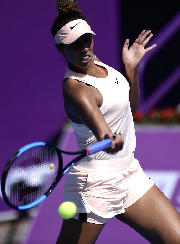 DOHA, Feb. 13, 2018 - Madison Keys of America hits a return during the singles first round match against Wang Qiang of China at the 2018 WTA Qatar Open in Doha, Qatar, on Feb. 13, 2018. Madison Keys ...