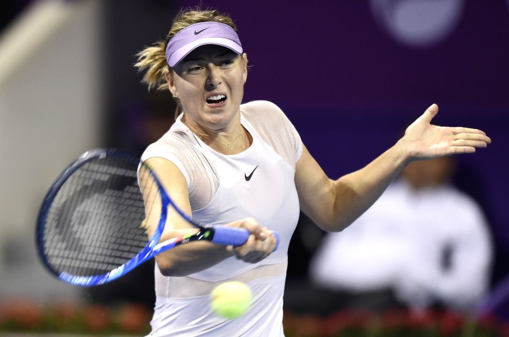 DOHA, Feb. 13, 2018 - Maria Sharapova of Russia hits a return during the single's first round match against Monica Niculescu of Romania at the 2018 WTA Qatar Open in Doha, Qatar, on Feb. 12, 2018. ...