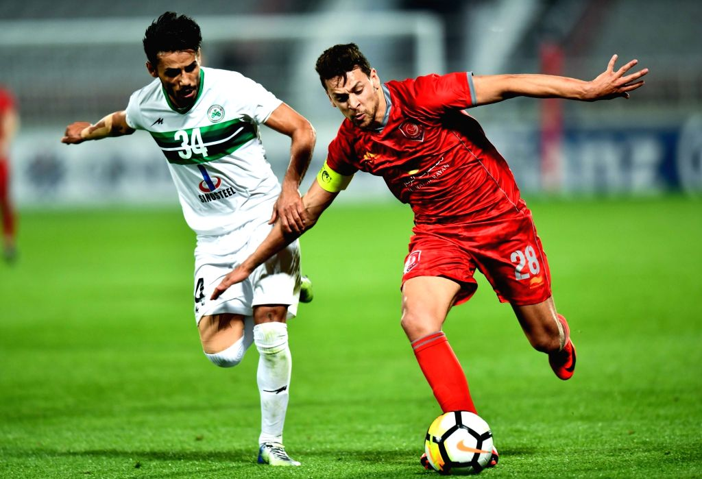DOHA, Feb. 13, 2018 - Milad Fakhreddini (L) of Iran's Zob Ahan Esfahan F.C vies for the ball with Youssef Msakni of Qatar's AL Duhail SC during the AFC Asian Champions L eague group B football match ...