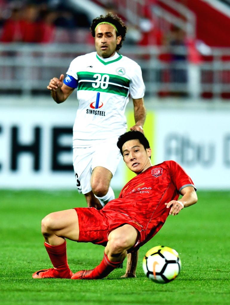 DOHA, Feb. 13, 2018 - Nam Tae-hee (Bottom) of Qatar's AL Duhail SC vies for the ball with Mehdi Rajabzadeh (L) of Iran's Zob Ahan Esfahan F.C during the AFC Asian Champions League group B football ...