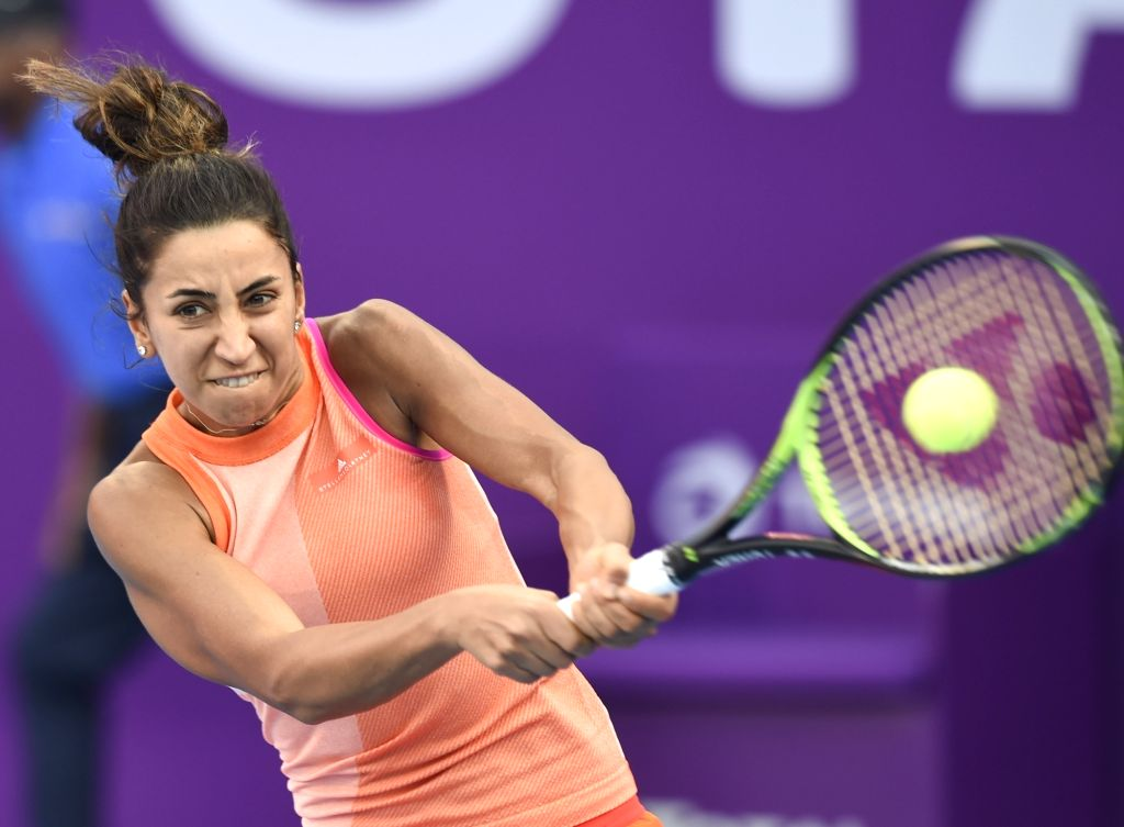DOHA, Feb. 14, 2018 - Cagla Buyukakcay of Turkey hits a return during the single's first round match against Petra Kvitova of Czech Republic at the 2018 WTA Qatar Open in Doha, Qatar, on Feb. 13, ...