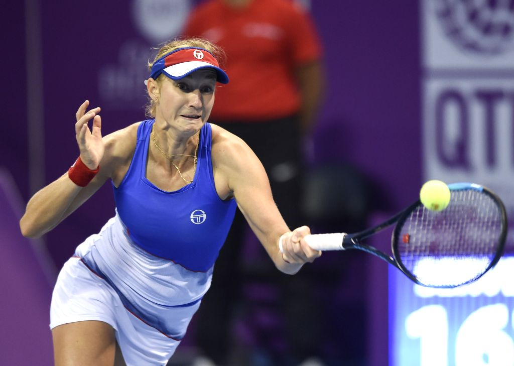 DOHA, Feb. 14, 2018 - Ekaterina Makarova of Russia returns the ball during the single's second round match against Simona Halep of Romania at the 2018 WTA Qatar Open in Doha, Qatar, on Feb. 14, 2018. ...