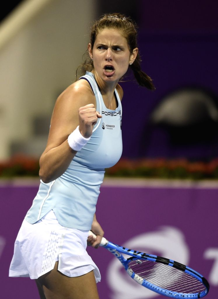 DOHA, Feb. 14, 2018 - Julia Goerges of Germany celebrates during the single's first round match against Lucie Safarova of Czech Republic at the 2018 WTA Qatar Open in Doha, Qatar, on Feb. 13, 2018. ...