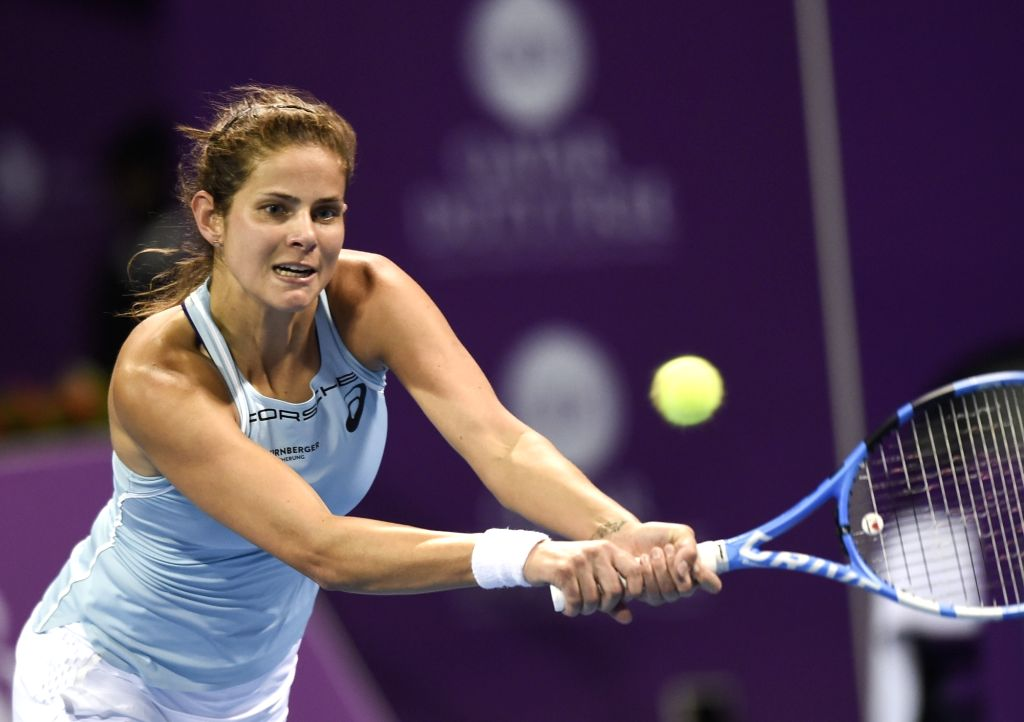 DOHA, Feb. 14, 2018 - Julia Goerges of Germany hits a return during the single's first round match against Lucie Safarova of Czech Republic at the 2018 WTA Qatar Open in Doha, Qatar, on Feb. 13, ...