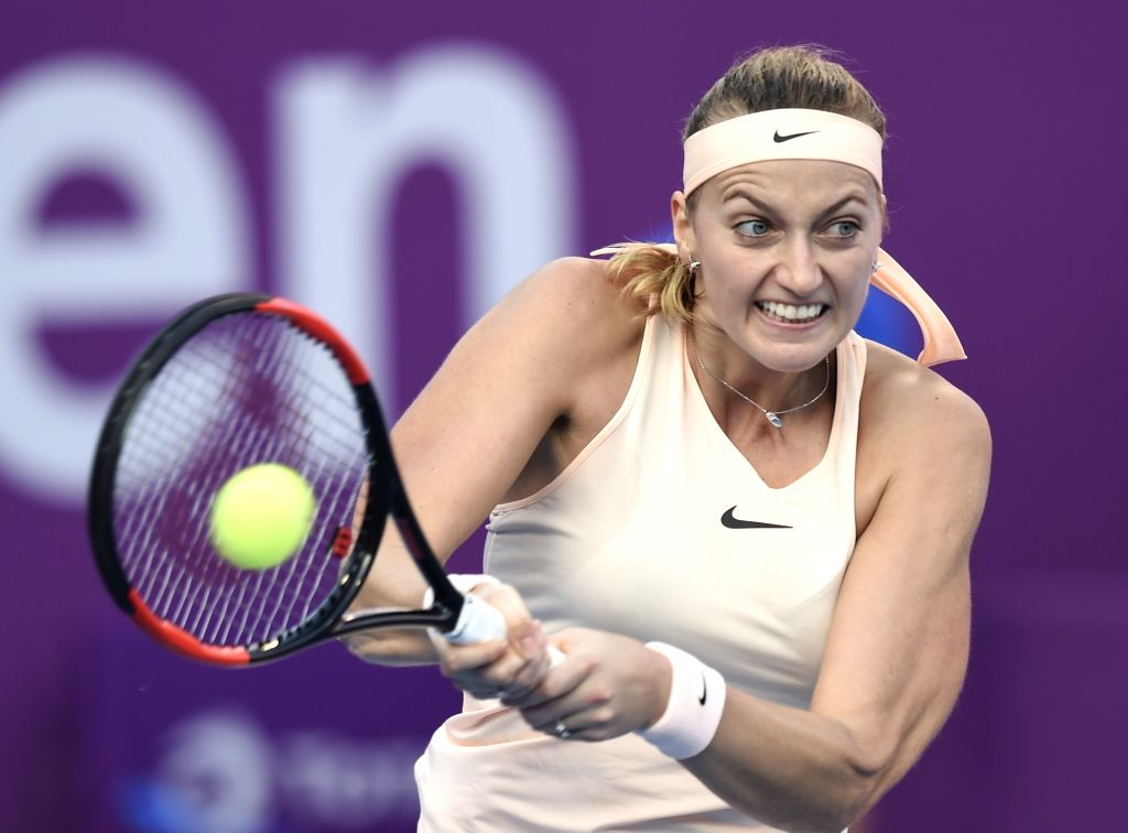 DOHA, Feb. 14, 2018 - Petra Kvitova of Czech Republic hits a return during the single's first round match against Cagla Buyukakcay of Turkey at the 2018 WTA Qatar Open in Doha, Qatar, on Feb. 13, ...