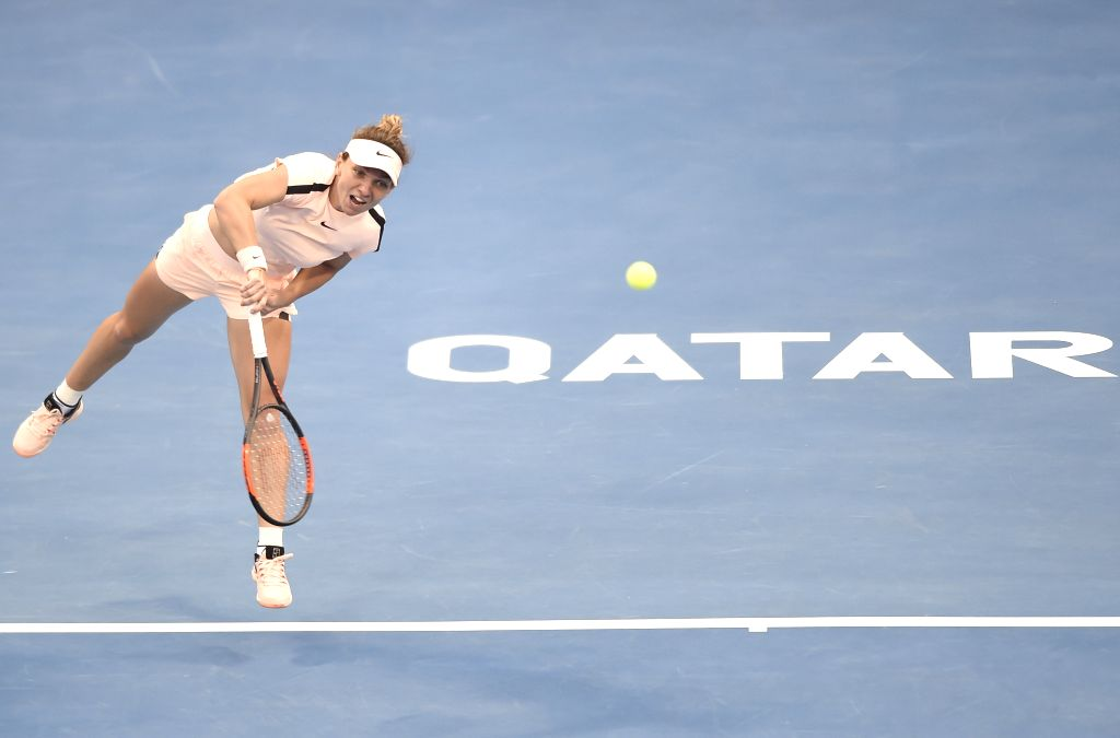 DOHA, Feb. 14, 2018 - Simona Halep of Romania serves during the single's second round match against Ekaterina Makarova of Russia at the 2018 WTA Qatar Open in Doha, Qatar, on Feb. 14, 2018. Simona ...