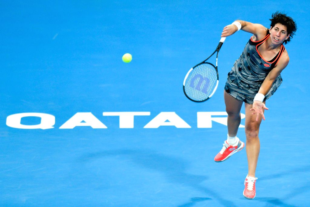 DOHA, Feb. 14, 2019 - Carla Suarez Navarro of Spain serves during the women's singles second round match between Kiki Bertens of the Netherlands and Carla Suarez Navarro of Spain at the 2019 WTA ...