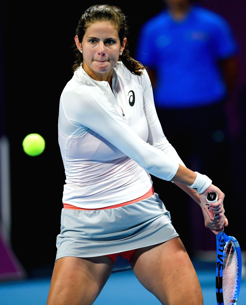 DOHA, Feb. 15, 2019 - Julia Goerges of Germany hits a return during the women's singles quarterfinal between Simona Halep of Romania and Julia Goerges of Germany at the 2019 WTA Qatar Open in Doha, ...