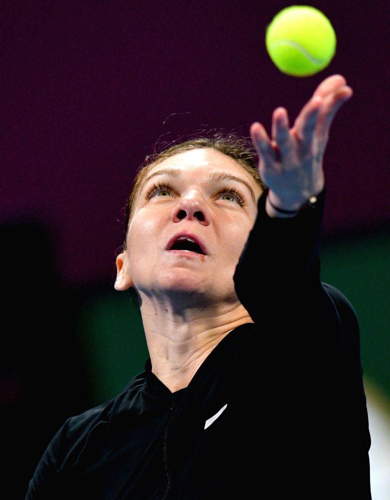 DOHA, Feb. 15, 2019 - Simona Halep of Romania serves during the women's singles quarterfinal between Simona Halep of Romania and Julia Goerges of Germany at the 2019 WTA Qatar Open in Doha, Qatar, ...
