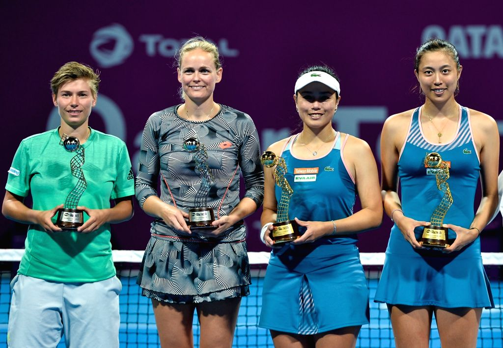 DOHA, Feb. 17, 2019 - Demi Schuurs (1st L) of the Nederlands, Anna-Lena Groenefeld (2nd L) of Germany, Hao-Ching Chan (1st R) and Latisha Chan of Chinese Taipei pose for photos during the awarding ...