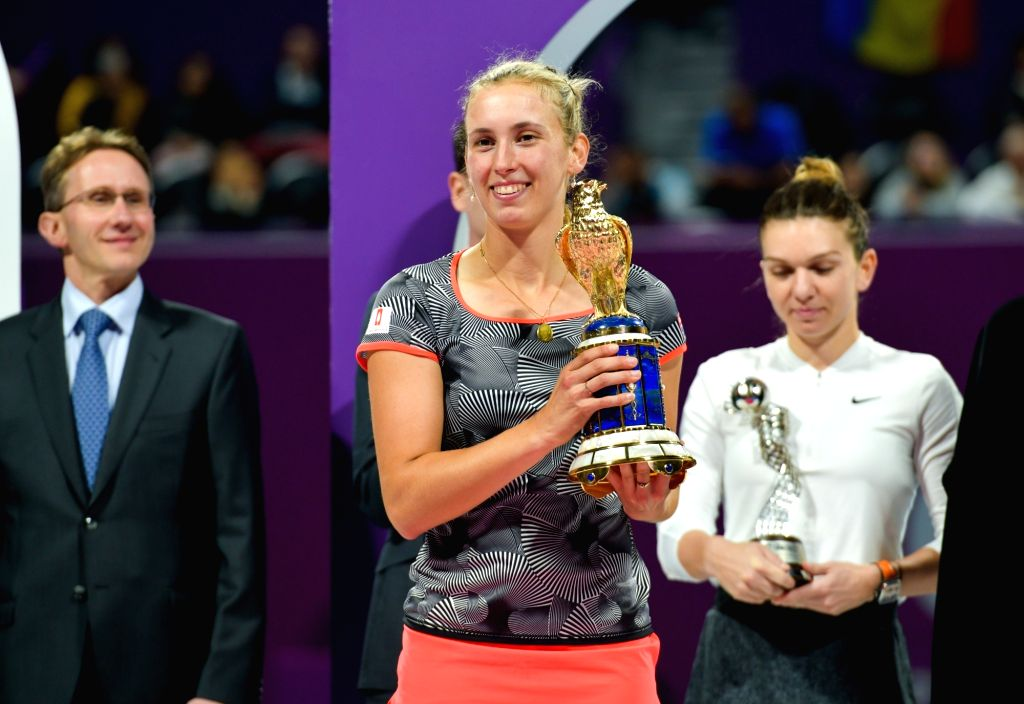 DOHA, Feb. 17, 2019 - Elise Mertens (front) of Belgium poses with the trophy after winning the single's final match against Simona Halep of Romania at the 2019 WTA Qatar Open in Doha, Qatar, on Feb. ...