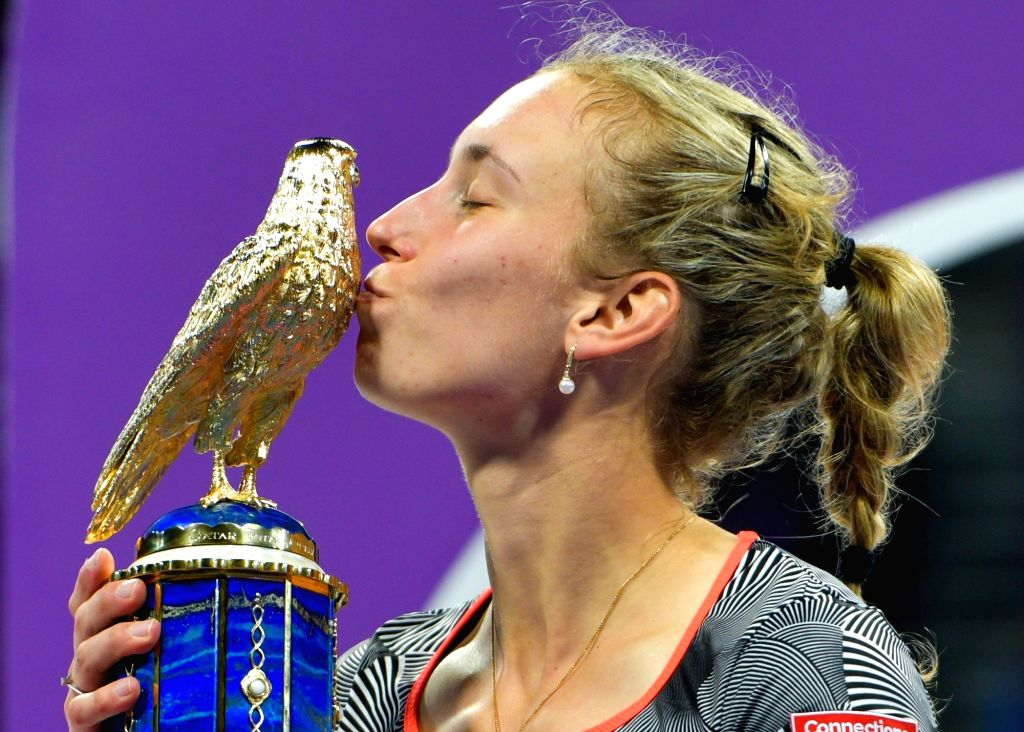 DOHA, Feb. 17, 2019 - Elise Mertens of Belgium kisses the trophy after winning the single's final match against Simona Halep of Romania at the 2019 WTA Qatar Open in Doha, Qatar, on Feb. 16, 2019. ...
