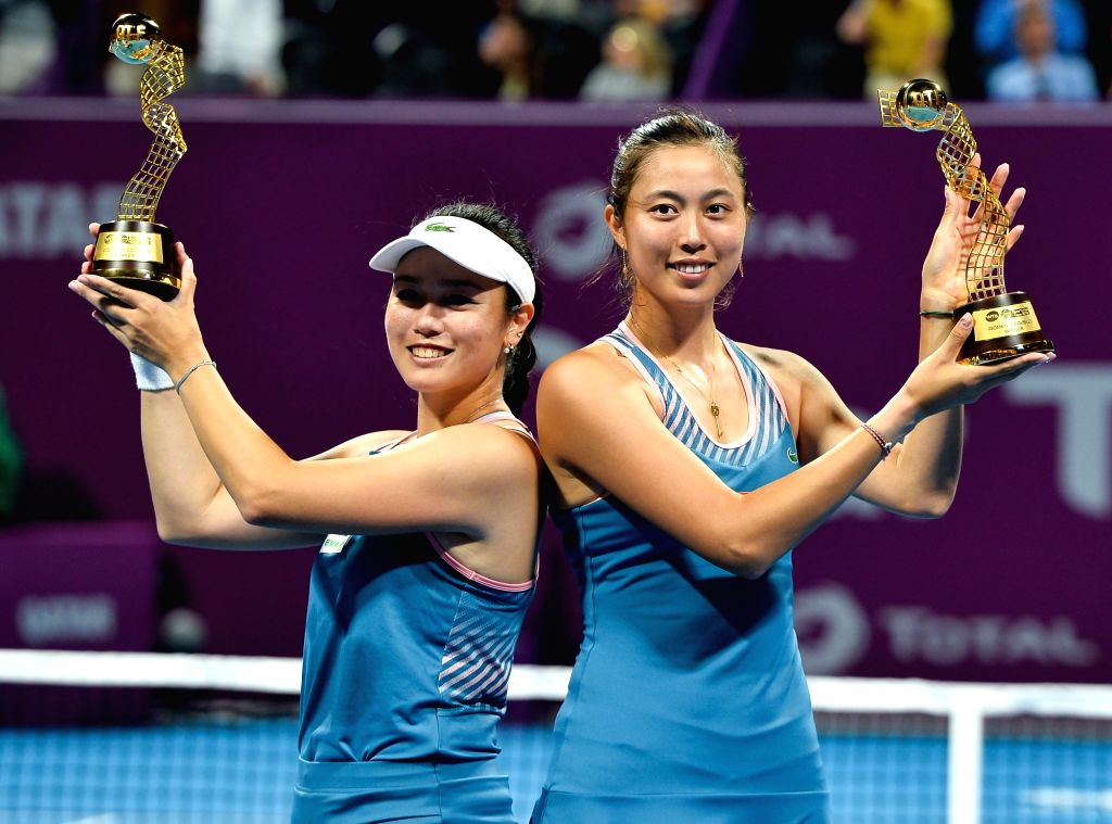 DOHA, Feb. 17, 2019 - Hao-Ching Chan (R) and Latisha Chan of Chinese Taipei hold up the trophy during the awarding ceremony after the doubles final against Demi Schuurs of the Nederlands and ...