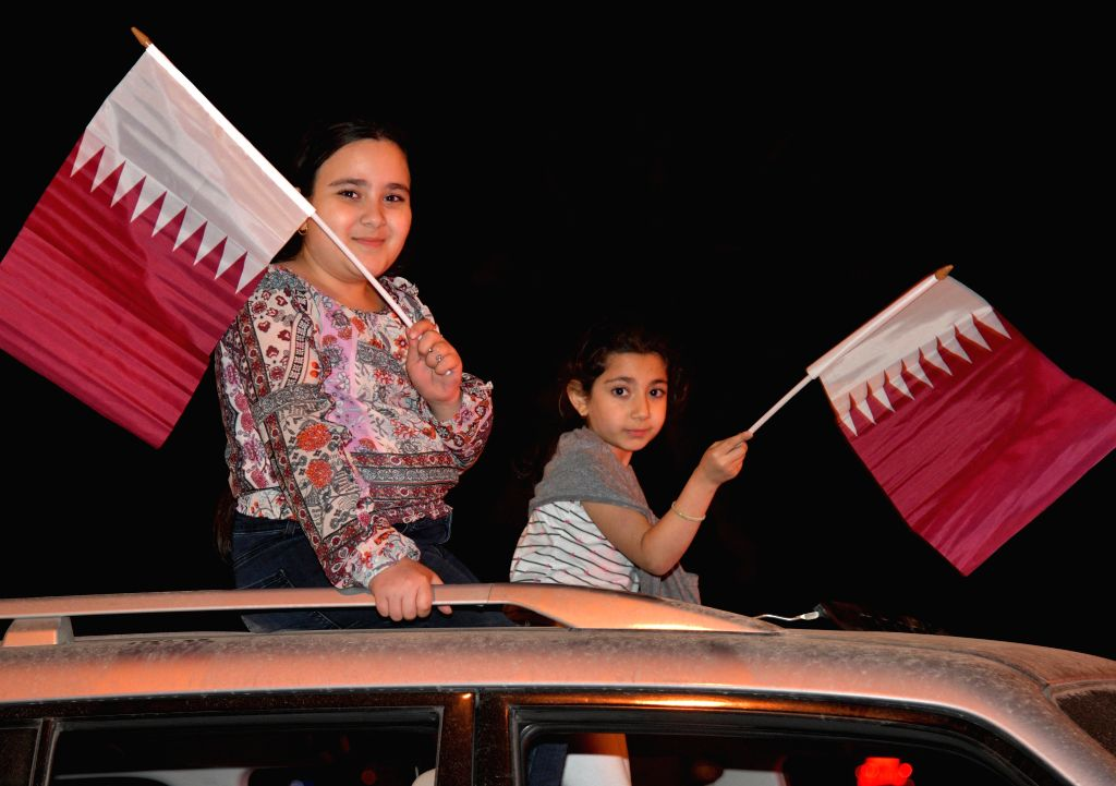 DOHA, Feb. 2, 2019 - Fans of Qatar celebrate at Doha Corniche after the final match between Japan and Qatar at the 2019 AFC Asian Cup in Doha, Qatar, on Feb. 1, 2019. Qatar won 3-1 to claim the title ...