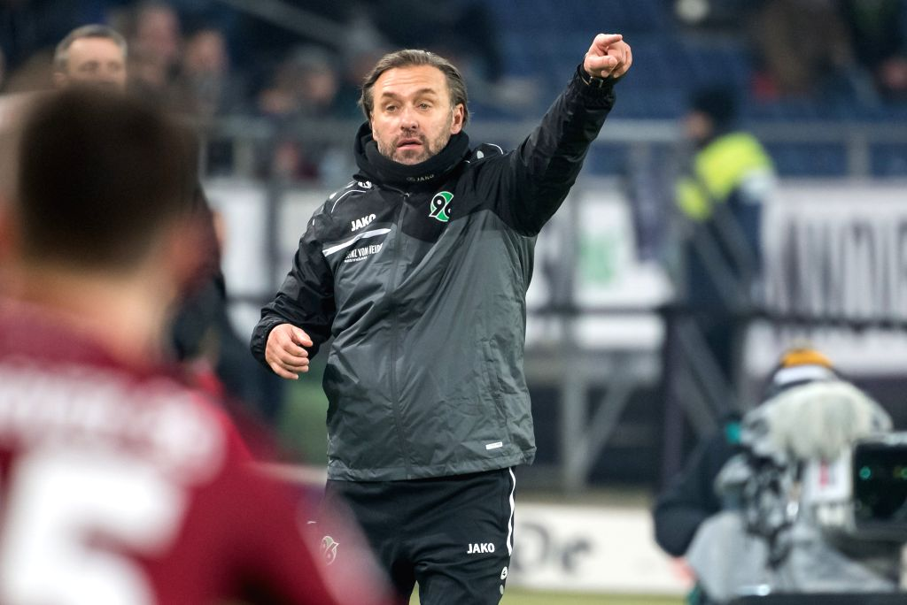 DOHA, Feb. 2, 2019 - Hanover 96's newly appointed head coach Thomas Doll reacts during his first German Bundesliga match as head coach of Hanover 96 against RB Leipzig, in Hanover, Germany, on Feb. ...
