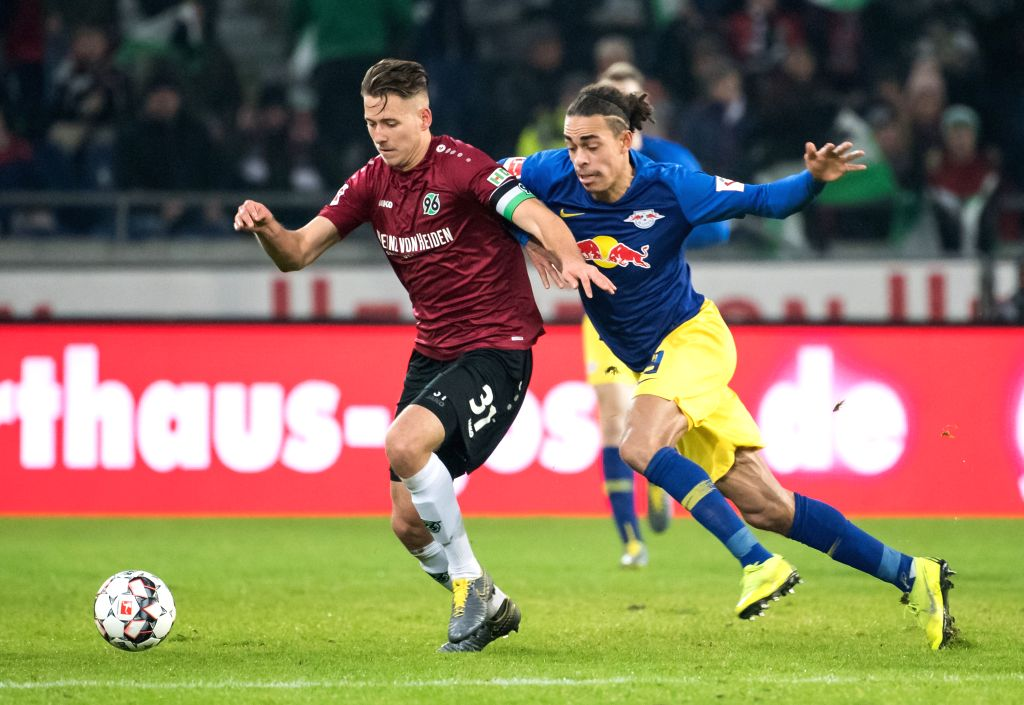 DOHA, Feb. 2, 2019 - Hanover 96's Waldemar Anton (L) vies with Leipzig's Yussuf Poulsen during a German Bundesliga match between Hanover 96 and RB Leipzig, in Hanover, Germany, on Feb. 1, 2019.