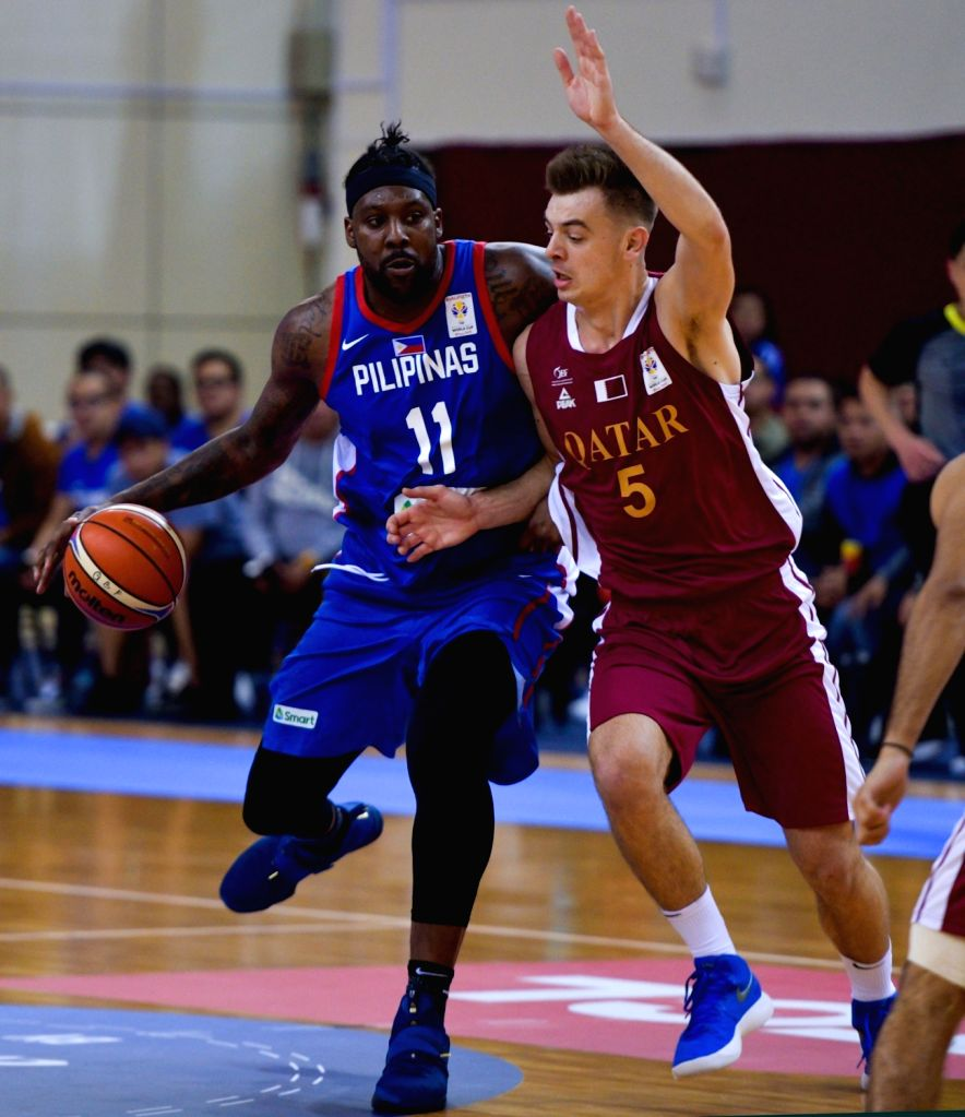 DOHA, Feb. 22, 2019 - Andray Blatche (L) of Philippines breaks through under the defence of Nedim Muslic of Qatar during the second round Group F match of the FIBA basketball World Cup 2019 Asian ...