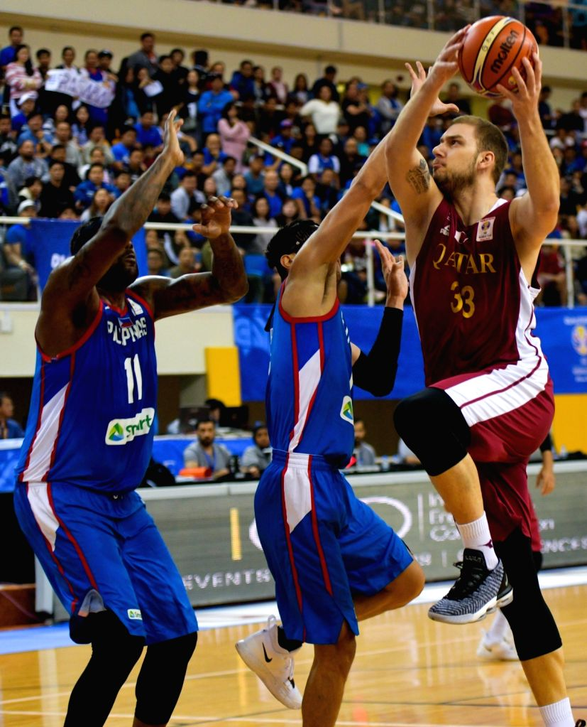 DOHA, Feb. 22, 2019 - Emir Mujkic (R) of Qatar goes for the basket during the second round Group F match of the FIBA basketball World Cup 2019 Asian Qualifiers between Qatar and Philippines in Doha, ...