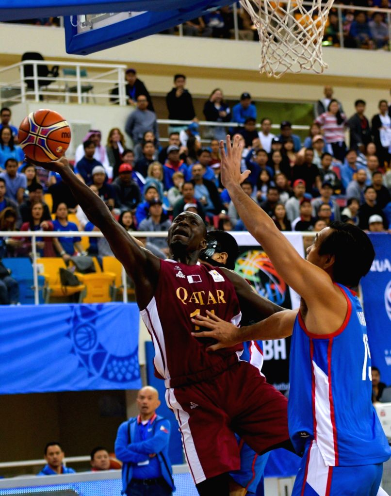 DOHA, Feb. 22, 2019 - Erfan Ali Saeed (L) of Qatar goes for the basket during the second round Group F match of the FIBA basketball World Cup 2019 Asian Qualifiers between Qatar and Philippines in ...
