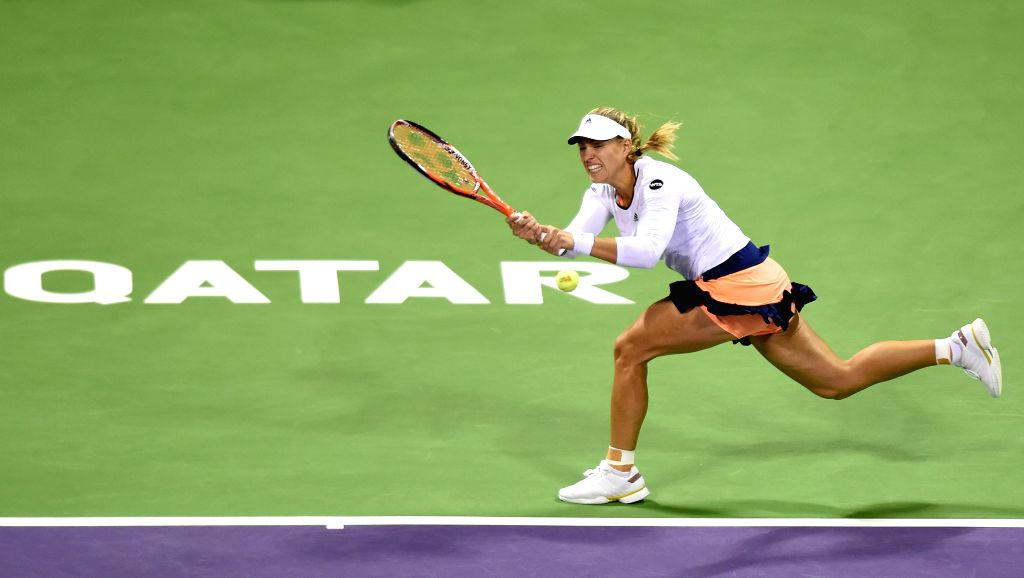Angelique Kerber of Germany returns the ball during the first round match against Victoria Azarenka of Belarus in the WTA Qatar Open tennis tournament in Doha, Qatar, ...