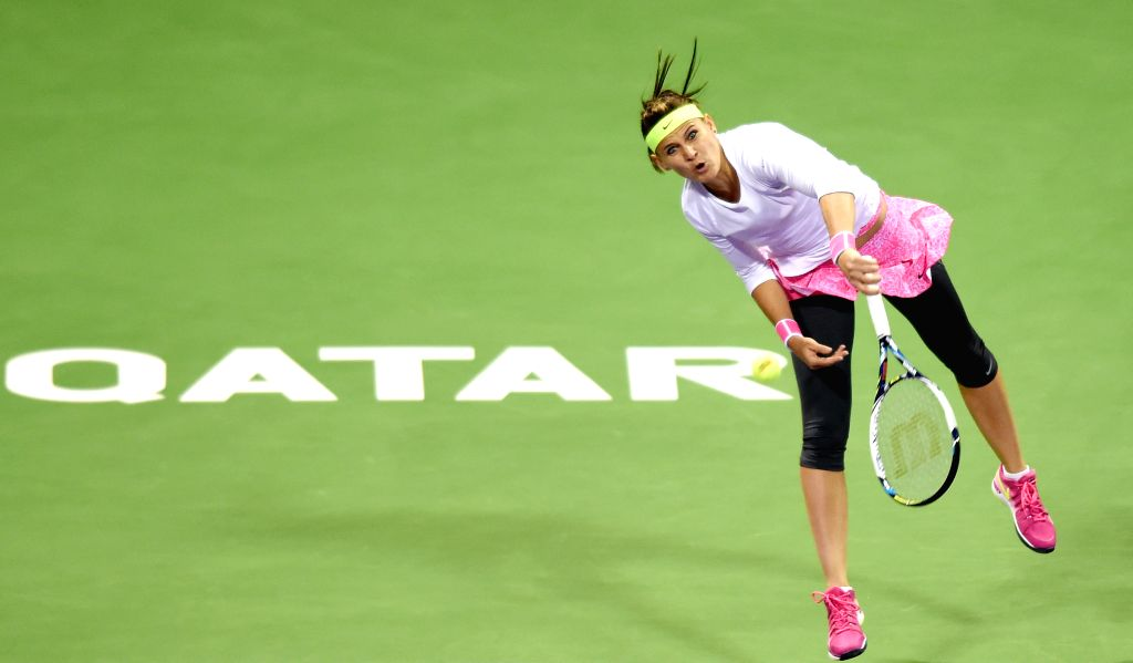 Lucie Safarova of the Czech Republic competes during the first round match against Samantha Stosur of Australia in the WTA Qatar Open tennis tournament in Doha, Qatar, ...
