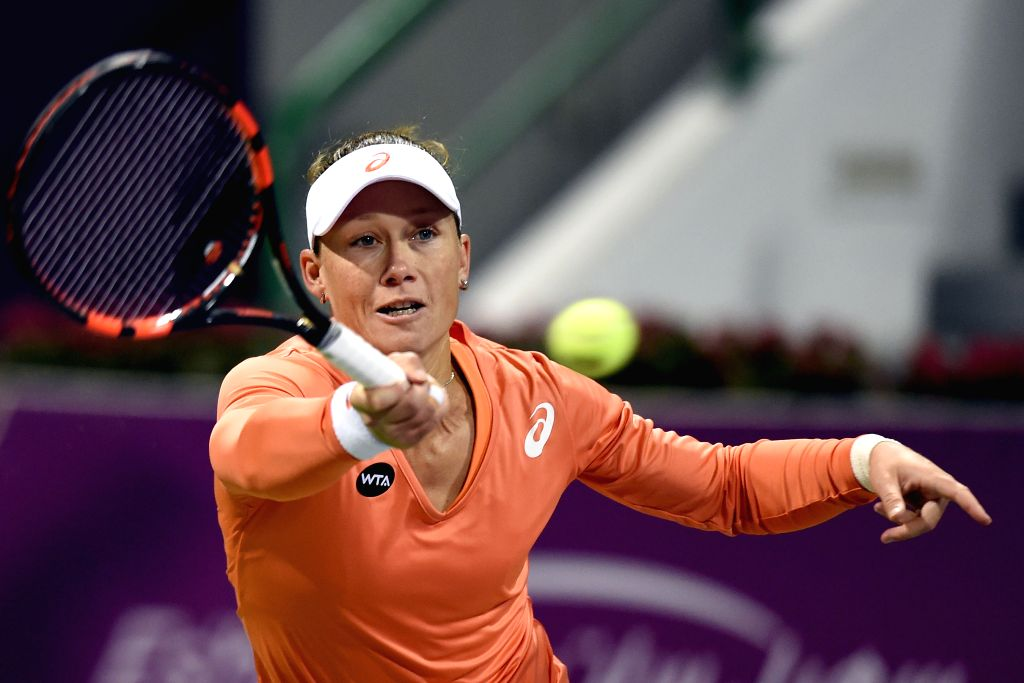 Samantha Stosur of Australia returns the ball during the first round match against Lucie Safarova of the Czech Republic in the WTA Qatar Open tennis tournament in ...