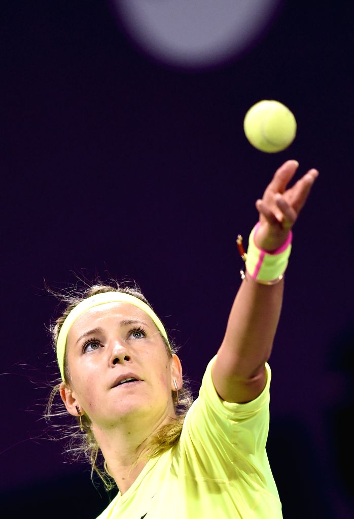 Victoria Azarenka of Belarus serves during the first round match against Angelique Kerber of Germany in the WTA Qatar Open tennis tournament in Doha, Qatar, Feb. 23, ...