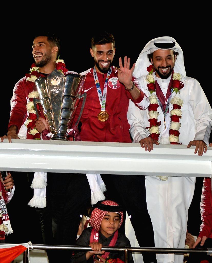 DOHA, Feb. 3, 2019 - Qatar national soccer team captain and forward Hasan Al Haydos (C) waves to fans upon arrival at Doha International Airport in Doha, Qatar on Feb. 2, 2019. Qatar won 3-1 over ...