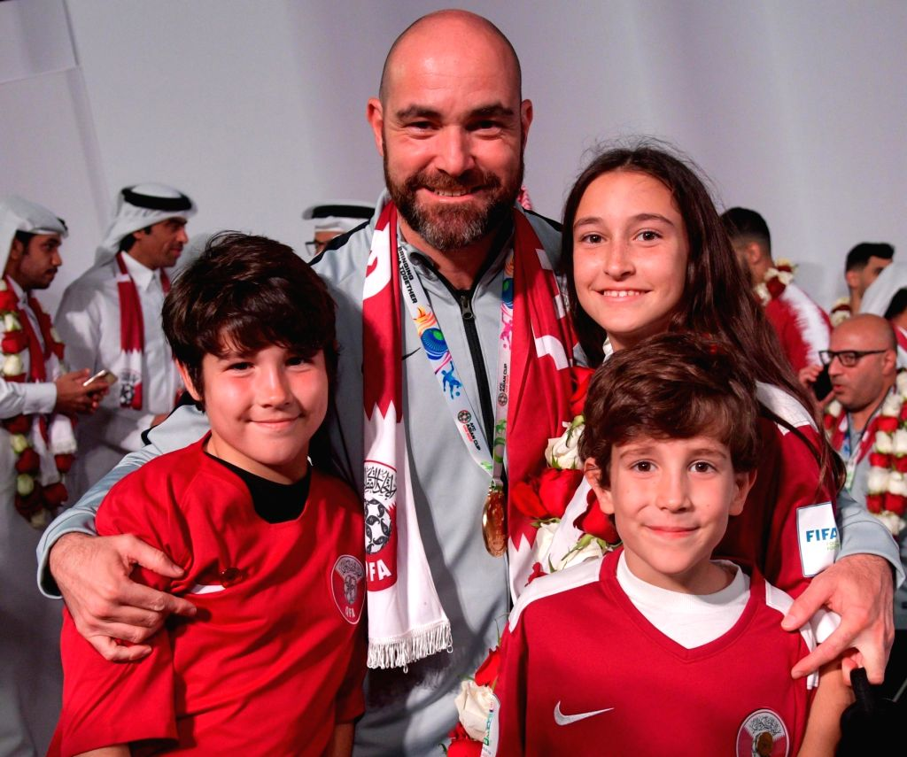 DOHA, Feb. 3, 2019 - Qatar national soccer team coach Felix Sanchez Bas of Spain poses with his children for a photo upon arrival at Doha International Airport in Doha, Qatar on Feb. 2, 2019. Qatar ...