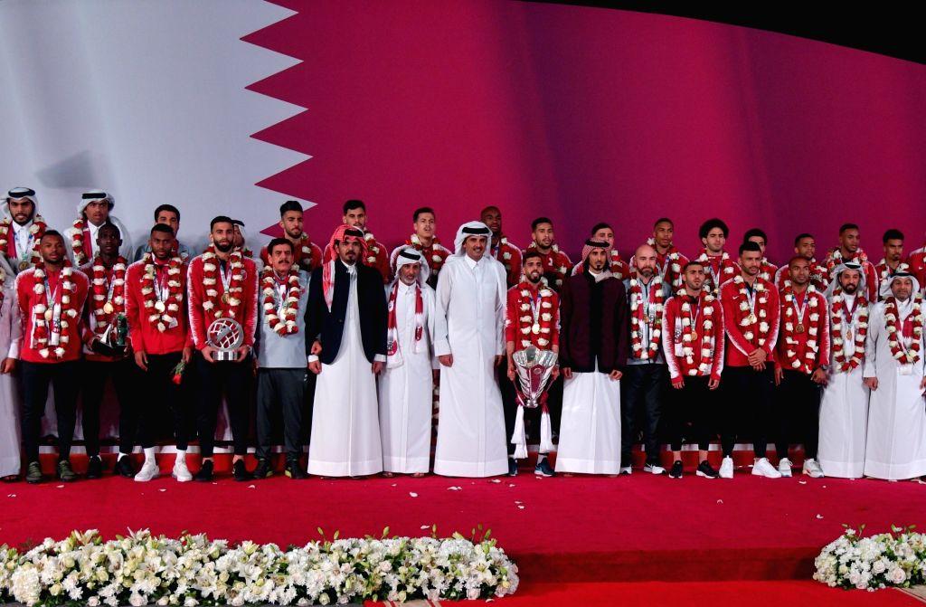 DOHA, Feb. 3, 2019 - Qatar's Emir Sheikh Tamim bin Hamad Al Thani (C) welcomes the Qatari national soccer team upon arrival at Doha International Airport in Doha, Qatar on Feb. 2, 2019. Qatar won 3-1 ... - Sheikh Tamim