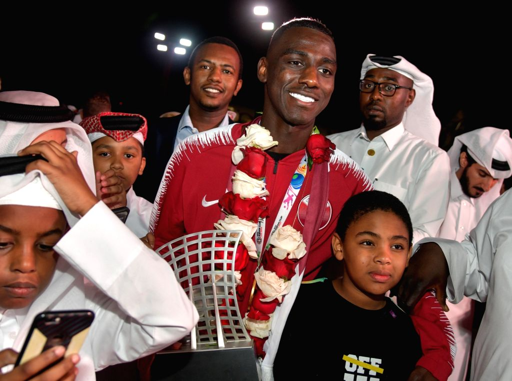 DOHA, Feb. 3, 2019 - Qatar's forward and 2019 AFC Asian Cup Most Valuable Player Almoez Ali (C) poses for pictures upon arrival at Doha International Airport in Doha, Qatar on Feb. 2, 2019. Qatar won ...