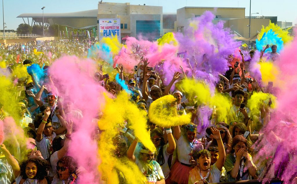 DOHA, Jan. 27, 2019 - People take part in the Color Run at the Qatar National Convention Centre in Doha, Qatar, on Jan. 26, 2019. Over 10,000 people participated in the Color Run which is aimed at ...