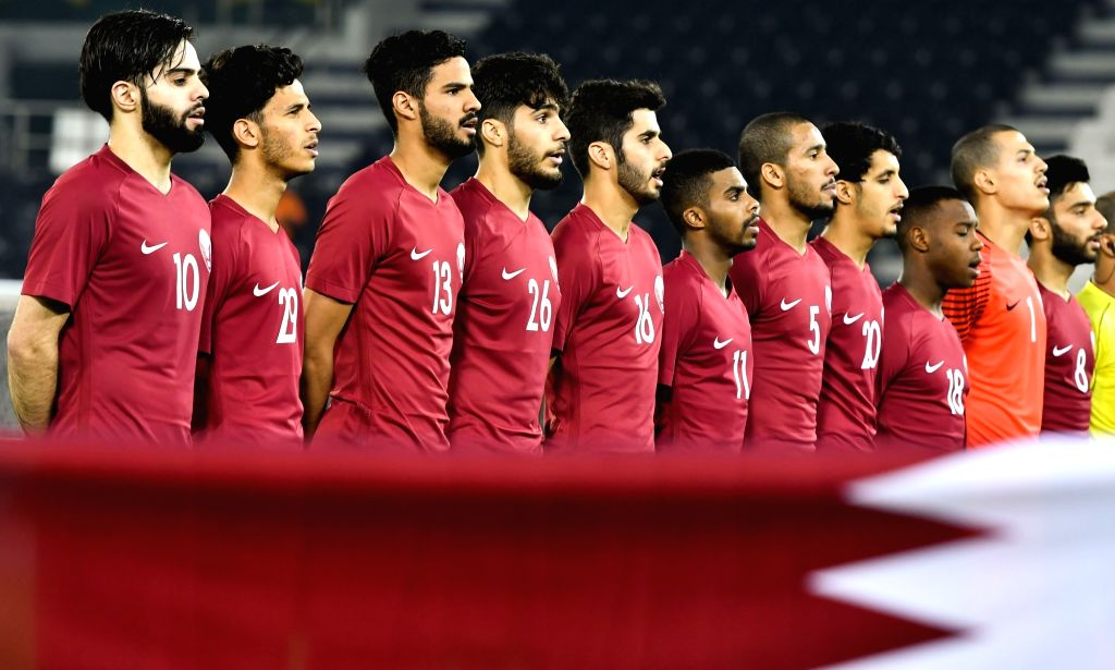DOHA, June 16, 2017 - Players of Qatar stand for their national anthem ahead of a U22 International friendly soccer match against Singapore at the Jassim Bin Hamad Stadium in Doha, capital of Qatar, ...