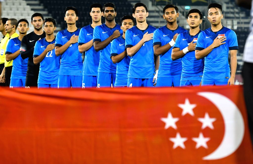 DOHA, June 16, 2017 - Players of Singapore stand for their national anthem ahead of a U22 International friendly soccer match against Qatar at the Jassim Bin Hamad Stadium in Doha, capital of Qatar, ...
