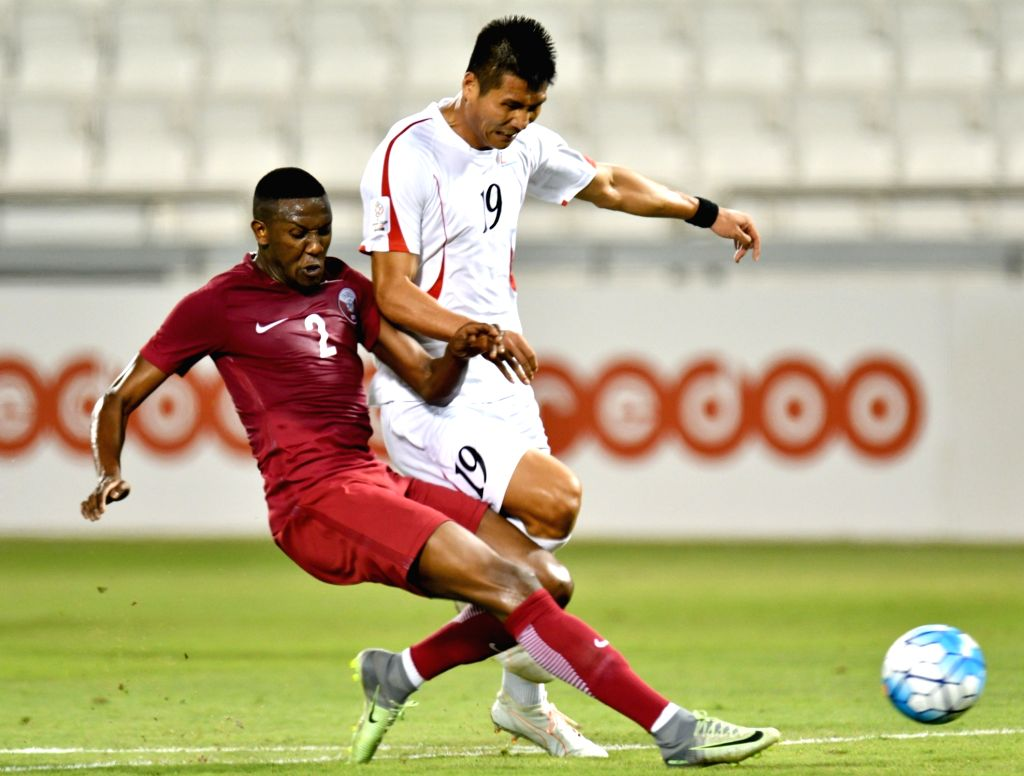 DOHA, June 7, 2017 - Mohammed Must Ali (L) of Qatar vies with Pak Kwang Ryong of DPRK during a friendly soccer match between Qatar and the Democratic People's Republic of Korea (DPRK) at the Jassim ...