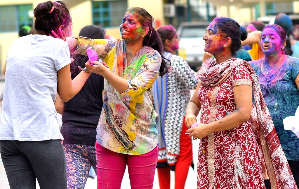 DOHA, March 14, 2017 - Girls of Indian community in Qatar throw colored powder on each other as they celebrate annual Holi, the Indian festival of Colors, in Doha, capital of Qatar, on March 13, ...