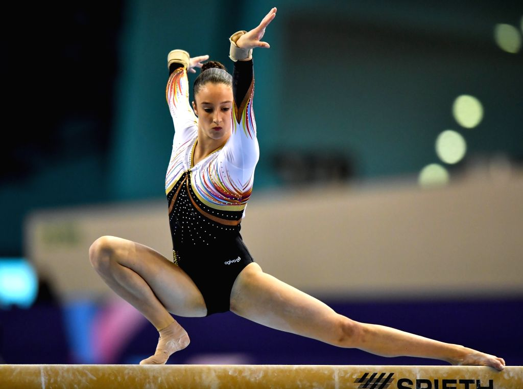 DOHA, March 23, 2018 - Nina Derwael of Belgium competes during the women's Balance Beam qualifying round of the 11th FIG Artistic Gymnastics World Cup in Doha, Capital of Qatar, on March 22, 2018.