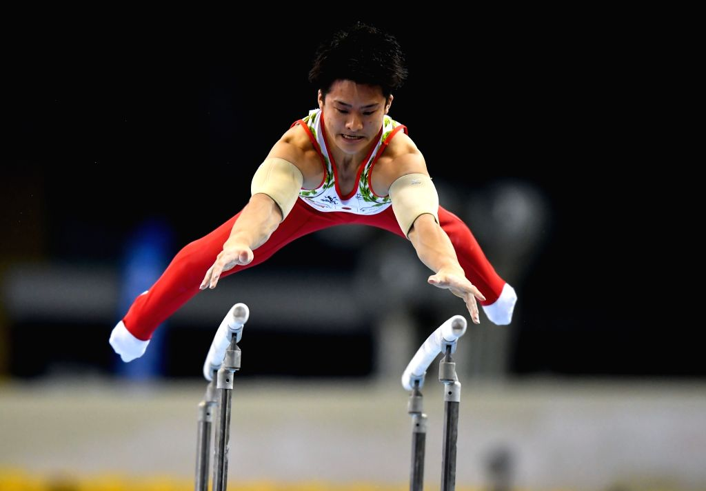 DOHA, March 23, 2018 - Yuya Kamoto of Japan competes during the Men's Parallel Bars qualifying round of the 11th FIG Artistic Gymnastics World Cup in Doha, Capital of Qatar, on March 22, 2018.