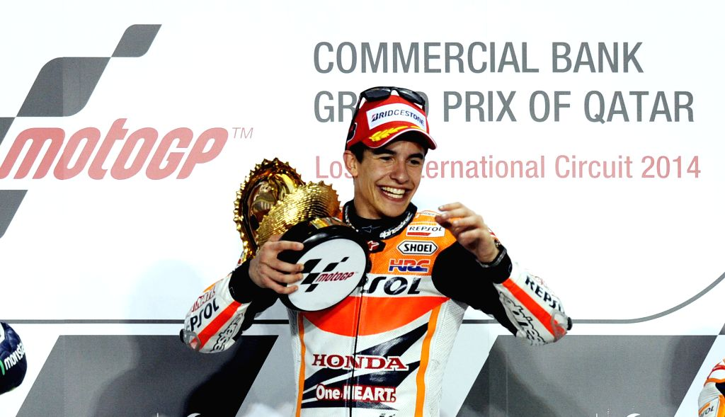 DOHA, March 24, 2014 (Xinhua) -- Winner Honda MotoGP Spanish rider Marc Marquez celebrates on the podium during the awarding ceremony for the Qatar MotoGP Grand Prix at the Losail International circuit in Doha, capital of Qatar, March 23, 2014. (Phot