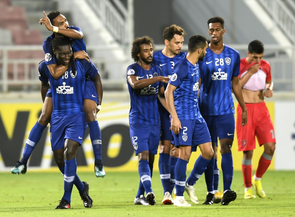 DOHA, May 21, 2019 - Bafetimbi Gomis (bottom L) of Al Hilal celebrates with his team mates after scoring their second goal during the AFC Champions League group C soccer match between Qatar's Al ...